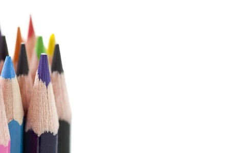 A close-up image of a colorful pencil on the side of white background photo