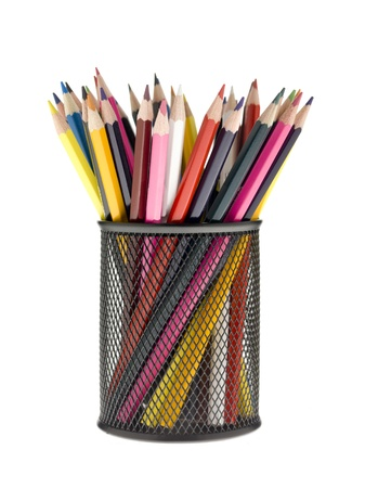 Close-up image of color pencils in metal holder. photo