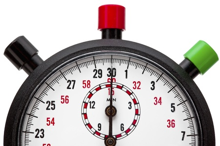 Macro shot of a cropped stopwatch with black, red and green push buttons against plain white background.
