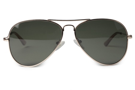 Close-up image of dark sunglasses isolated in a white surface photo