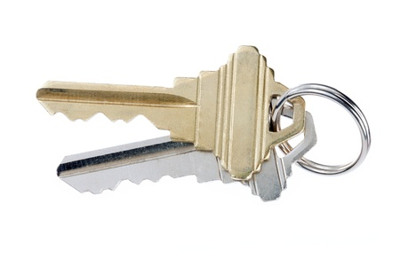 Close-up shot of gold and silver keys in key ring against white background. Stock Photo - 17185973