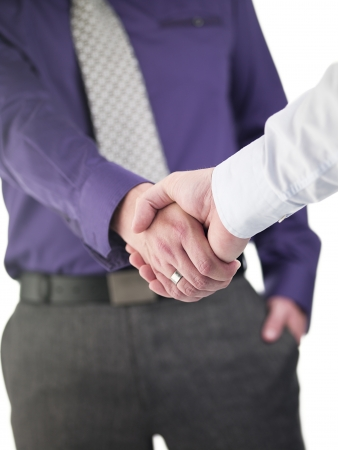 Doctor colleagues shaking hands against white background photo