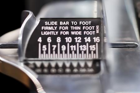 western script: Extreme close-up of brannock foot measurement machine. Stock Photo