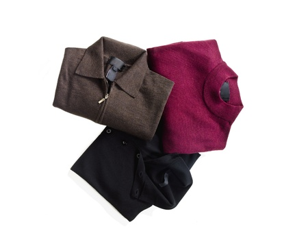 Image of three different color folded shirt over the white background