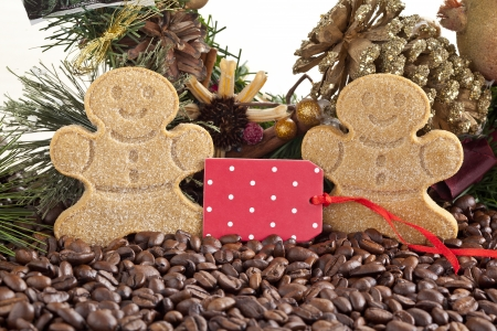 Close-up image of gingerbread cookies with coffee beans and pink tag. photo