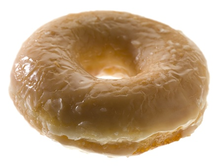 Close-up image of a glazed donut isolated on a white background Stock Photo