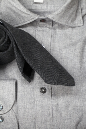dry cleaned: A close-up portrait of a gray polo with a black neck tie Stock Photo