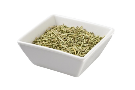 Herb of tea leaves on a white bowl