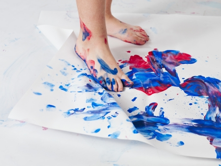 dirty feet: Close-up image of human foot printing footprint on piece of paper. Stock Photo