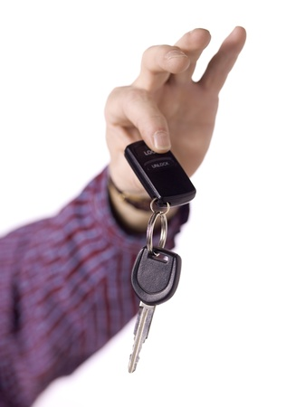 Close up image of a human hand holding a key against white background Stock Photo - 17185671