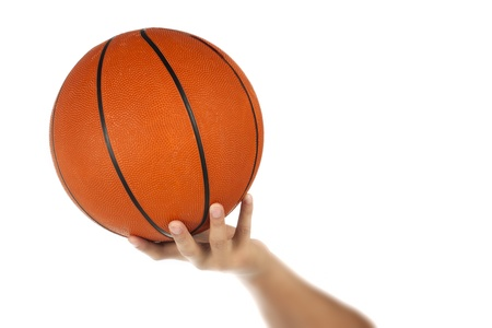 Close-up of human hand holding basketball over white background Stock Photo - 17186211