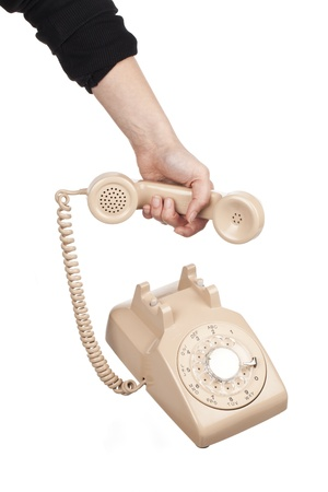 Close-up shot of hand holding receiver of rotary dial phone over white background Stock Photo - 17185608