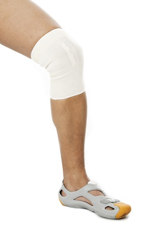 Image of human legs with knee band against white background Stock Photo - 17185920