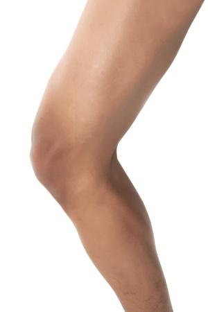 Cropped image of human leg on white background photo