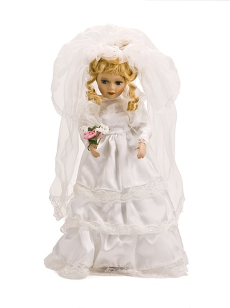 female likeness: Image of a fairy doll wearing a white gown.