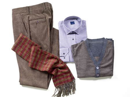 Image of pants with scarf and shirt against white background. Imagens - 17208130
