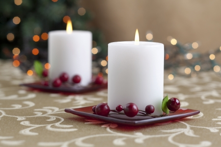 christmas backgrounds: A horizontal image of dinner table with two lighted candle Stock Photo