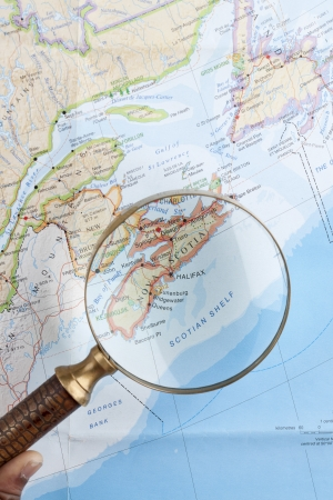 Close-up image of magnifying Nova Scotia on the world map photo