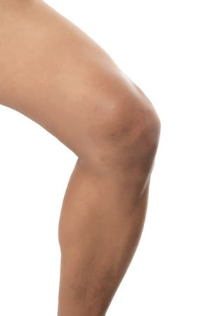 legs skin: Close-up cropped image of mans knee bending over the white background