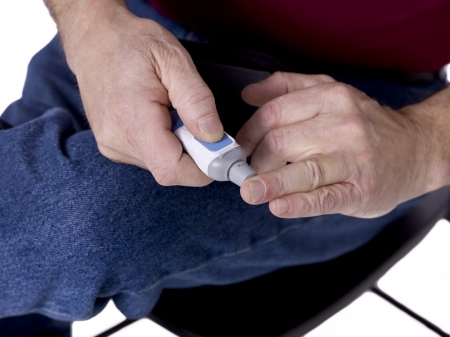 Image of man having blood sugar test
