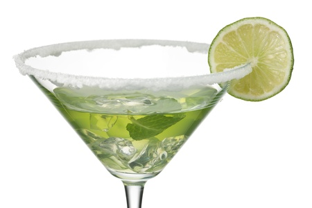 Close-up shot of martini glass with peppermint and lemon juice while lemon slice decorated on top. Stock Photo - 17185855