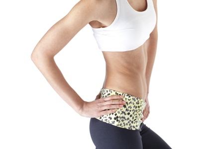 Attractive female with hands on hip over white background, midsection Imagens