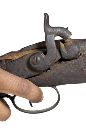 old rifle: Old rifle with a human hand Stock Photo