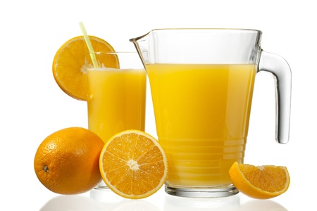 Image of orange slices and orange juice in jug and glass. Stock Photo - 17186746