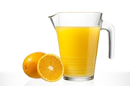 Close-up image of orange juice in jug while slice of orange on white surface. Stock Photo - 17185976