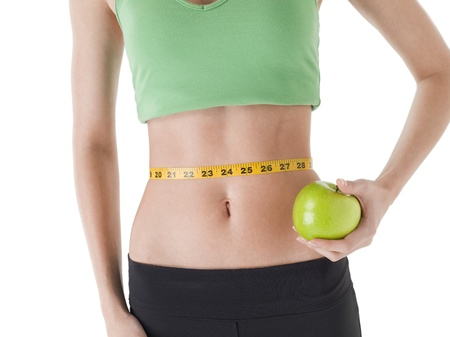 Green apple in her waist line Stock Photo - 17187245
