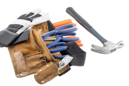 Image of a construction tool belt with hand gloves and hammer over white background Stock Photo - 17189835