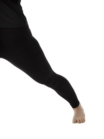 Woman thigh wearing a black leggings over a white background Stock Photo - 17185259