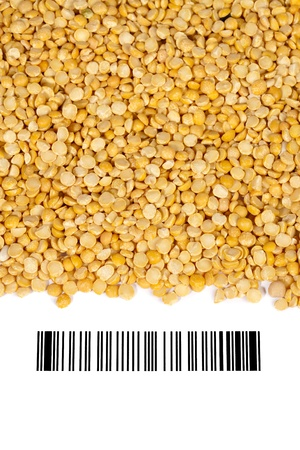 Close-up shot of yellow lentils and barcode on white background. photo