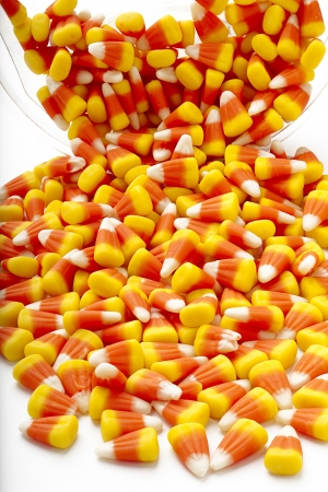 Pile of candy corn scattered on a white table. Stock Photo - 17208609