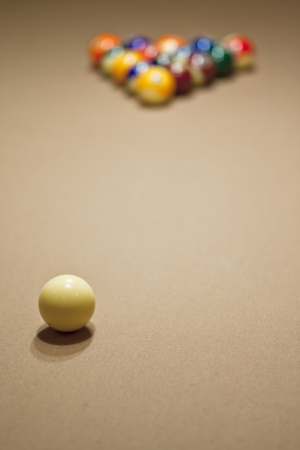 Pool balls arranged on pool table photo