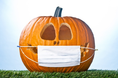 Portrait photo of a Jack O Lantern wearing a medical mask. Stock Photo - 17189683