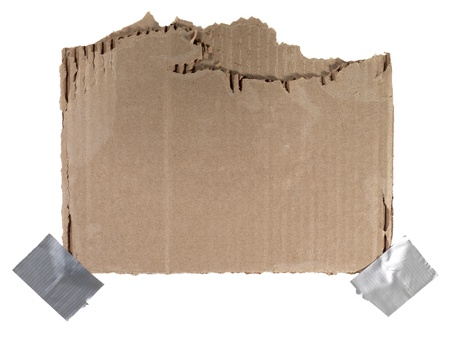 ripped: Close-up image of a ripped brown carton attached on a white background