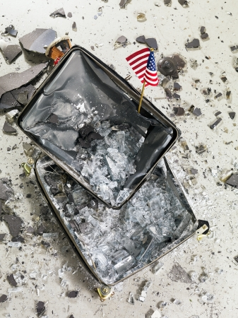 Image of a smashed television and USA flag Stock Photo - 17210580