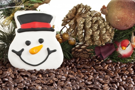 Snow man face cookies with christmas decor and coffee beans photo