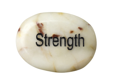 Close-up shot of strength inscribed on white bar of soap. Фото со стока