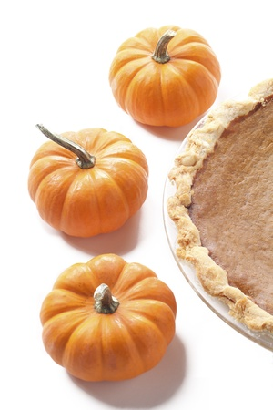 Top view of pumpkins and pumpkin pie served over white background. Stock Photo - 17187195