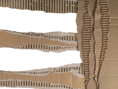 Pieces of torn cardboard over a white background Reklamní fotografie