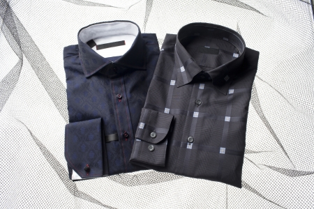 dry cleaned: An image of two dark color shirt isolated Stock Photo