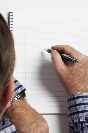 Cropped image of a businessman writing notes. Stock Photo - 17178255
