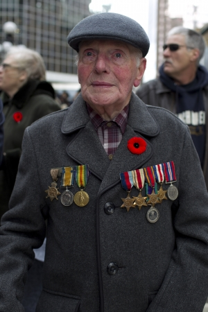 military uniform: View of a senior citizen wearing cap and military uniform on Remembrance Day. Editorial