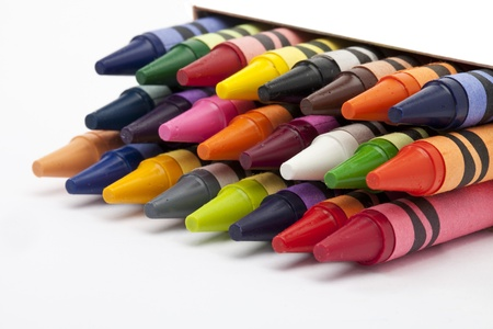 Close-up view of crayons stacked on a white background. Stok Fotoğraf