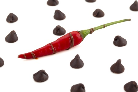 chilly: Chilly pepper with chocolate kisses isolated in a white background