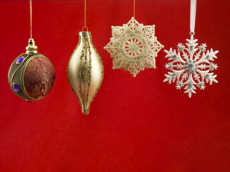 Close-up of christmas bauble against red background. photo