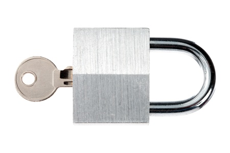Close-up shot of shiny padlock and metallic key against white background. Stock Photo - 17226226