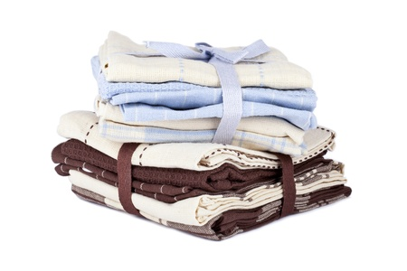 hanky: A pile of folded and colorful classy kitchen towel on a white background Stock Photo